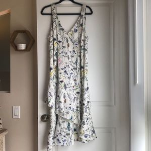 Silky floral print dress with ruffled hem. NWOT.